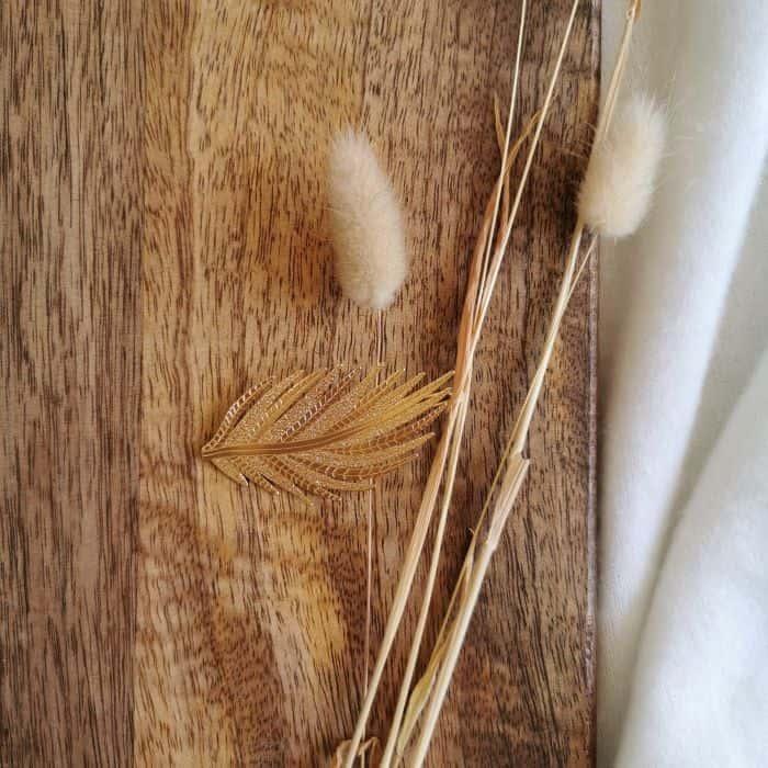 barrette doré en forme de plume