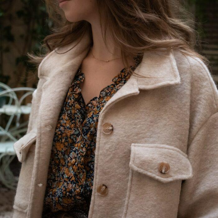 veste en laine écru avec poches frontales