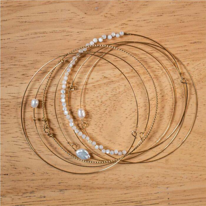 7 bracelets semainier doré à pierres blanches