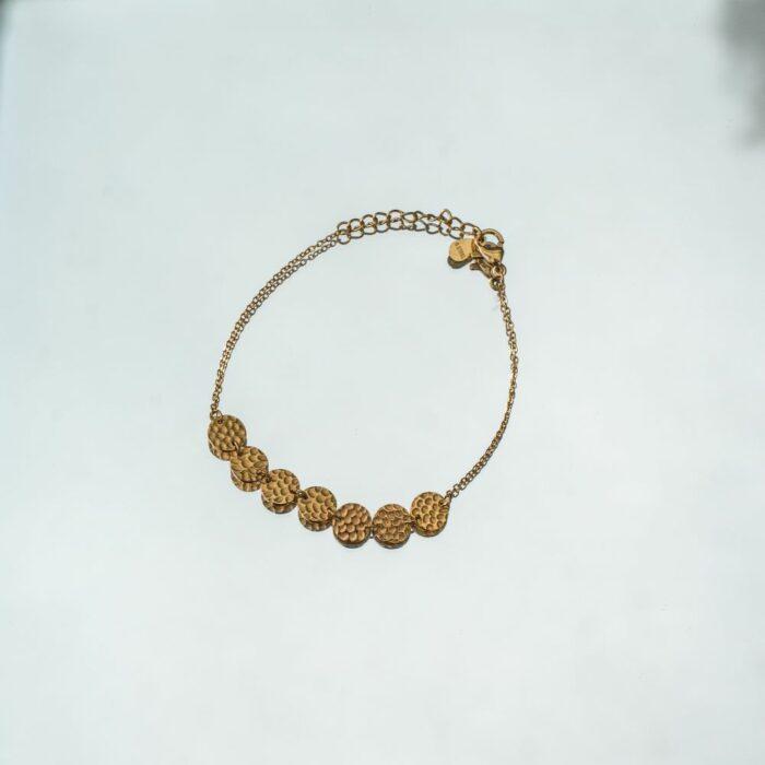 bracelet en acier inoxydable doré avec 7 pampilles rondes